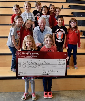 Photo of York Traditions Bank CFO/ COO, John Blecher, presenting EITC donation check to York Country Day School students.