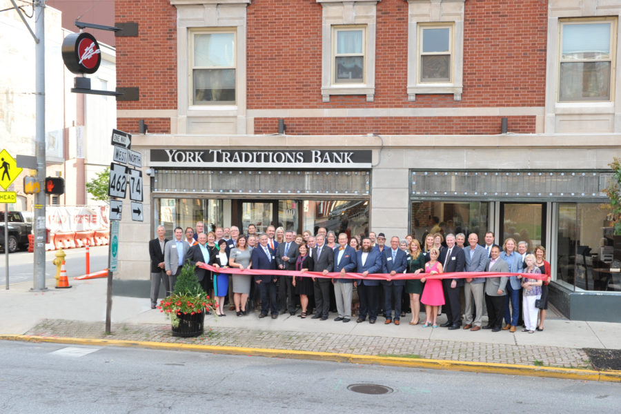 Representatives from the York community join the management of York Traditions Bank for a ribbon cutting ceremony on the afternoon of Tuesday, October 2, 2018 at the site of their new Downtown York branch at 100 North George Street.