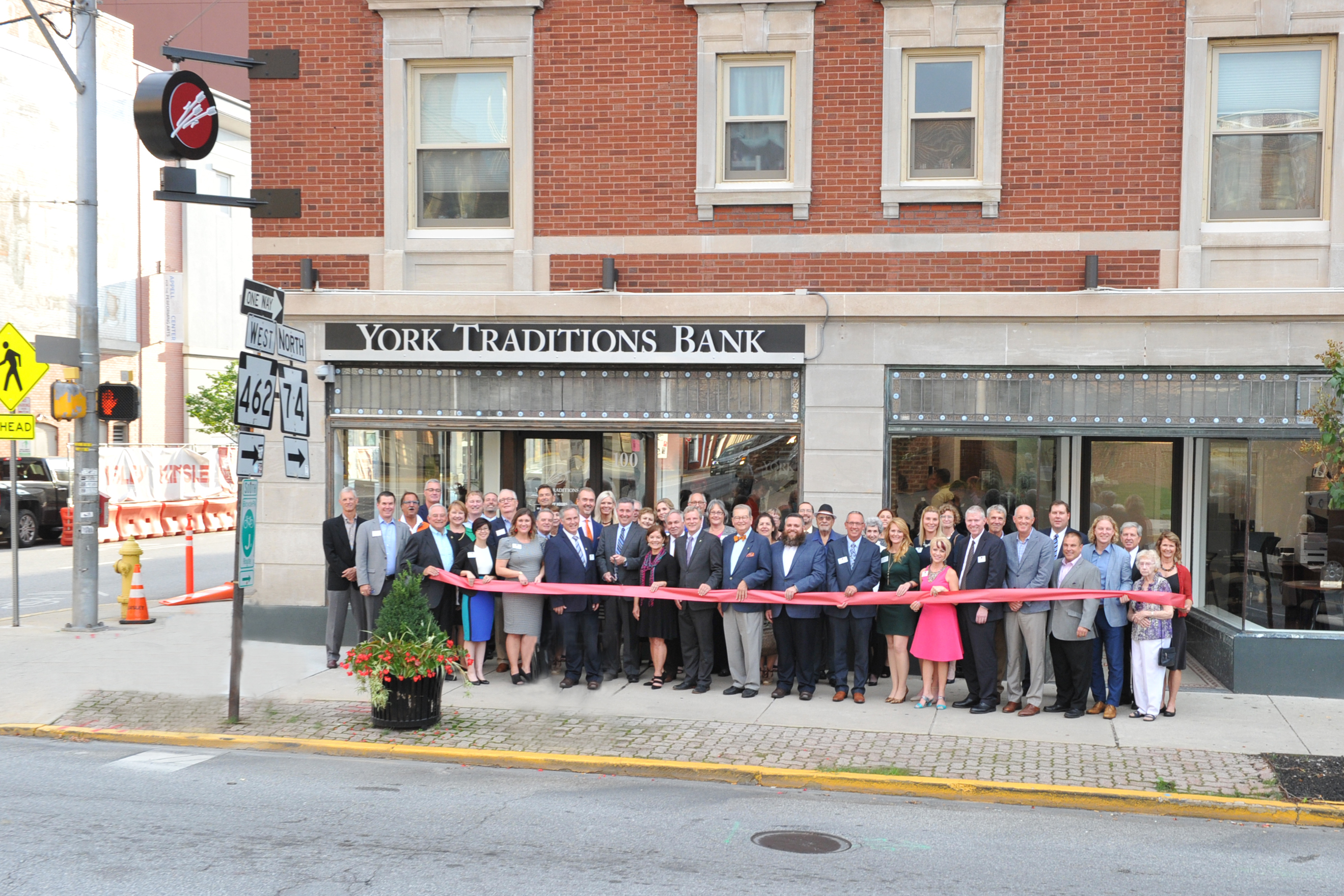 Representatives from the York community join the management of Traditions Bank for a ribbon cutting ceremony on the afternoon of Tuesday, October 2, 2018 at the site of their new Downtown York branch at 100 North George Street.
