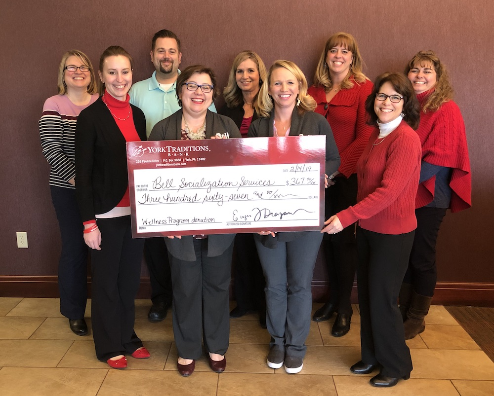 Photo of a check presentation given to Bell Socialization Services from York Traditions Bank, totaling $367. This donation was made from our wellness committee.