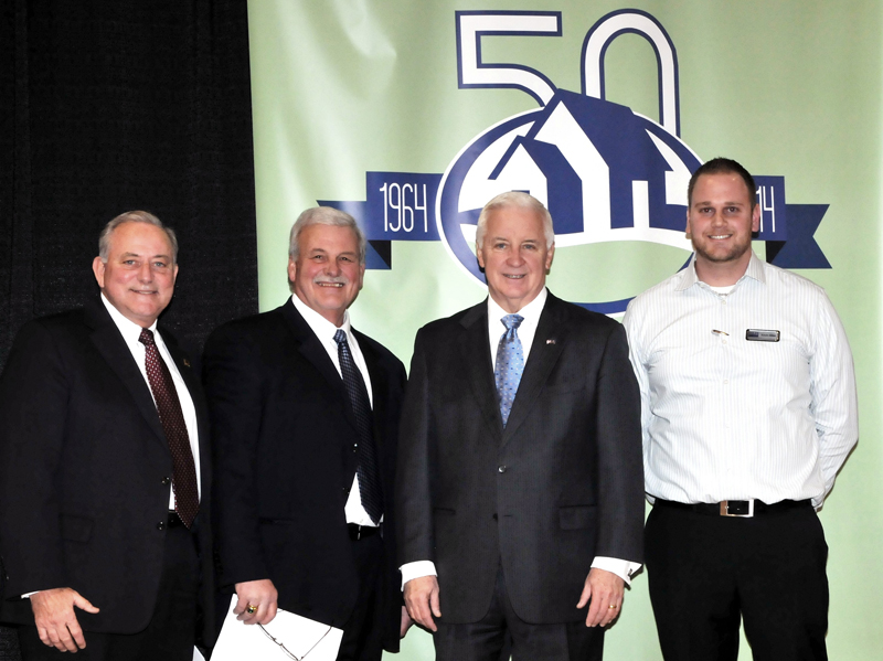 Pictured (L to R) are Mike Kochenour, President and CEO of Traditions Bank; Barry Strine, President of Strine's Heating and Air Conditioning and President of the York Builders Association; Tom Corbett, Governor of the state of Pennsylvania; and Kevin Miles, President of Miles Maytag Home Appliance Center.
