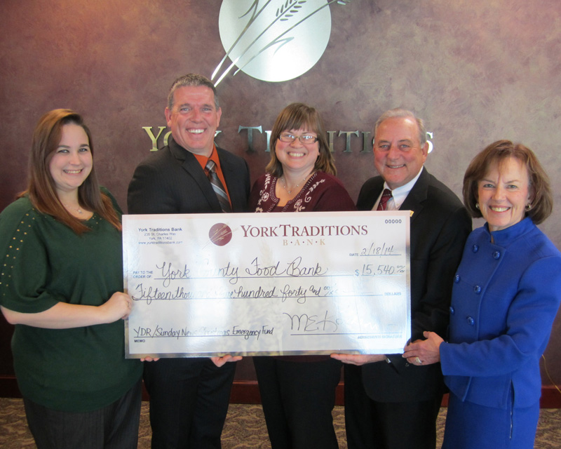 Pictured are (L to R) Amanda Shank and Jonathan Fisher from the York County Food Bank, along with Melissa Moore, Mike Kochenour and Carolyn Schaefer from Traditions Bank.