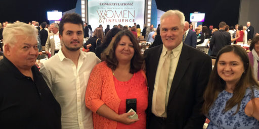 With Dr. Teresa Gregory, are (left to Right) her father, Daniel Decker, Sr.; her son, Logan Minnich; her husband, Tom Gregory; and her daughter, Megan Minnich; who helped celebrate her achievements at the Women of Influence Awards on June 26.