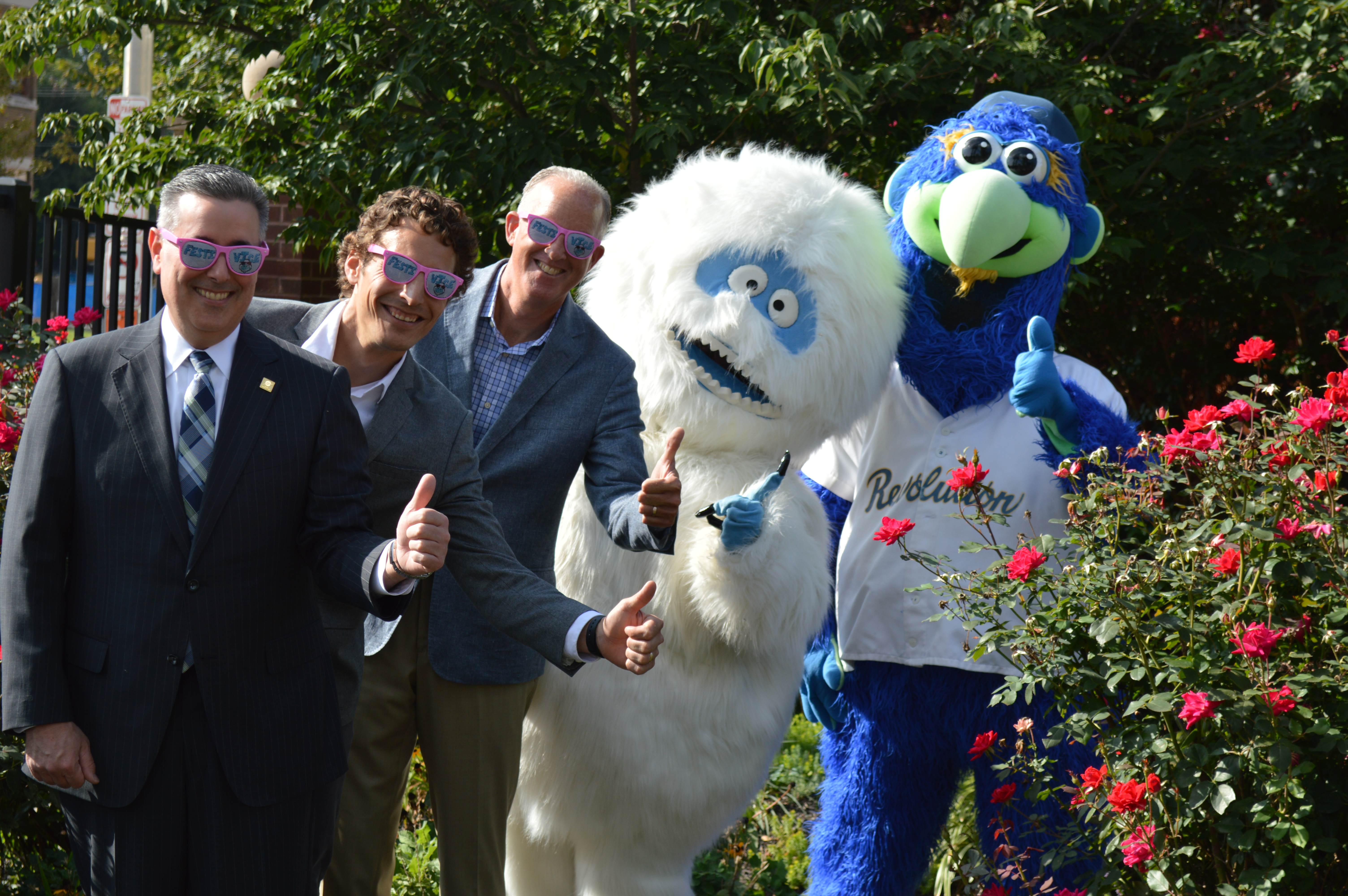 Traditions Bank President & CEO Eugene Draganosky, left, Eventive Director Adam Nugent, and York Revolution President Eric Menzer join the FestivICE Yeti and Revolution mascot DownTown in celebrating the extension of Traditions Bank's sponsorship of Eventive.