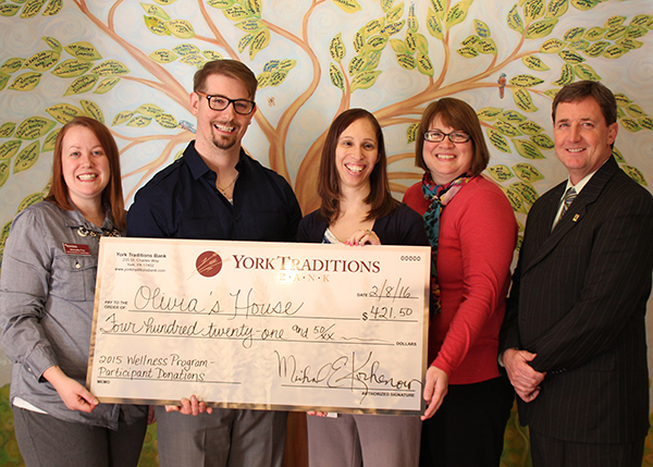 Pictured (left to right): Michelle Fox, Olivia's House Administrative Coordinator, and K.C. Delp, Olivia's House Executive Director, accept a donation from York Traditions Bank Wellness Committee Co-Chairs Kristi Riley-Platt, Loan Administration Team Leader, and Melissa Moore, Personal Banking Delivery Specialist, along with Mike Sharp, York Traditions Bank Business Services Partner and Olivia's House Board Member.