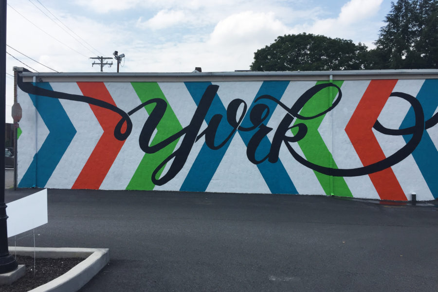 a wall side mural with color arrows and YORK written in fancy font