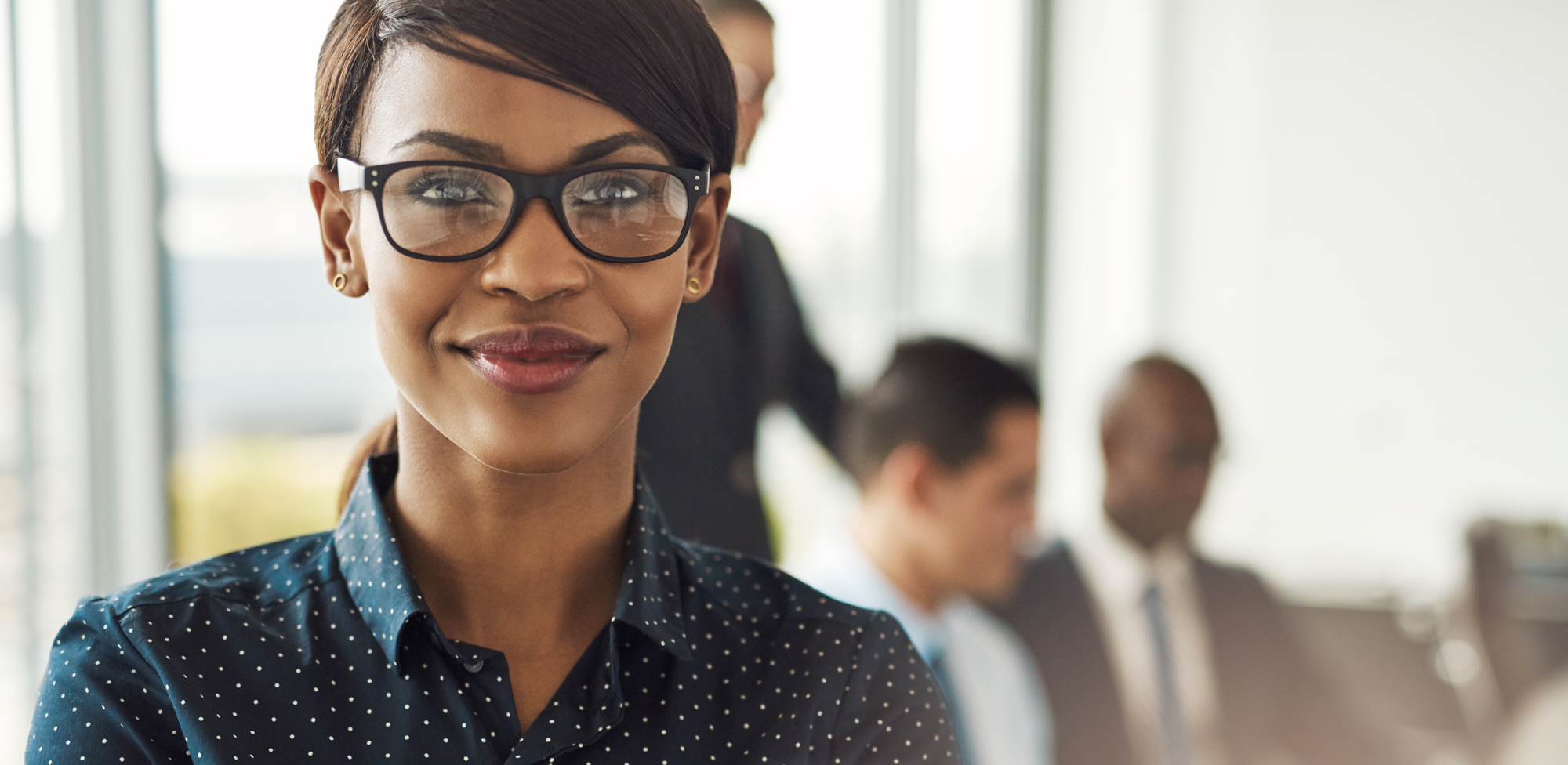 business woman smiling in conference room