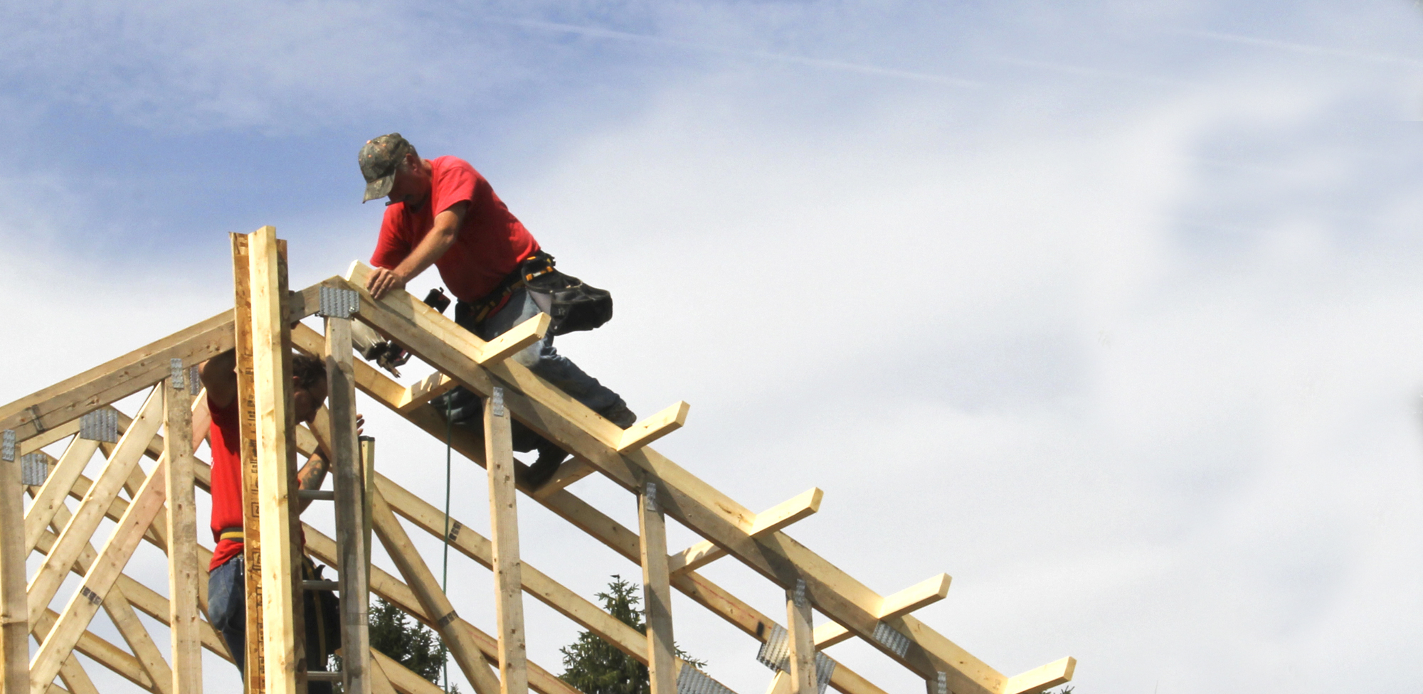 builders working on house beams