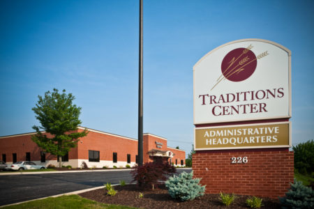 Traditions Center administrative headquarters sign and building