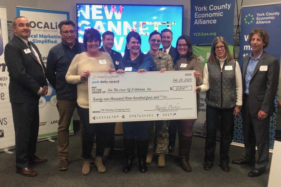 Traditions Bank Business Services Partners, Mike Kelly (left) and Mike Sharp (4th from left), who are also Veterans, were proud to help present the check from the Christmas Emergency Fund to