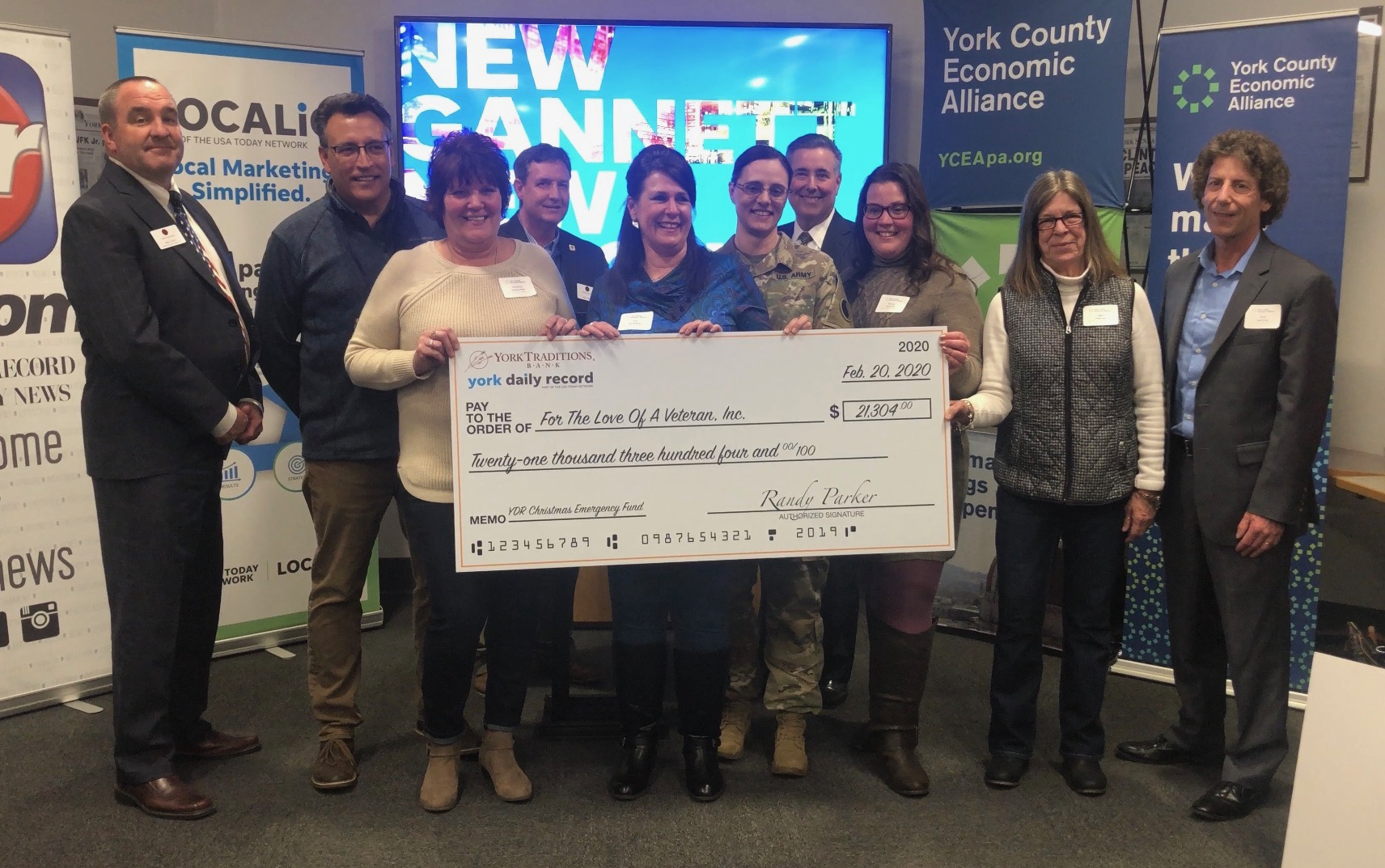 York Traditions Bank Business Services Partners, Mike Kelly (left) and Mike Sharp (4th from left), who are also Veterans, were proud to help present the check from the Christmas Emergency Fund to