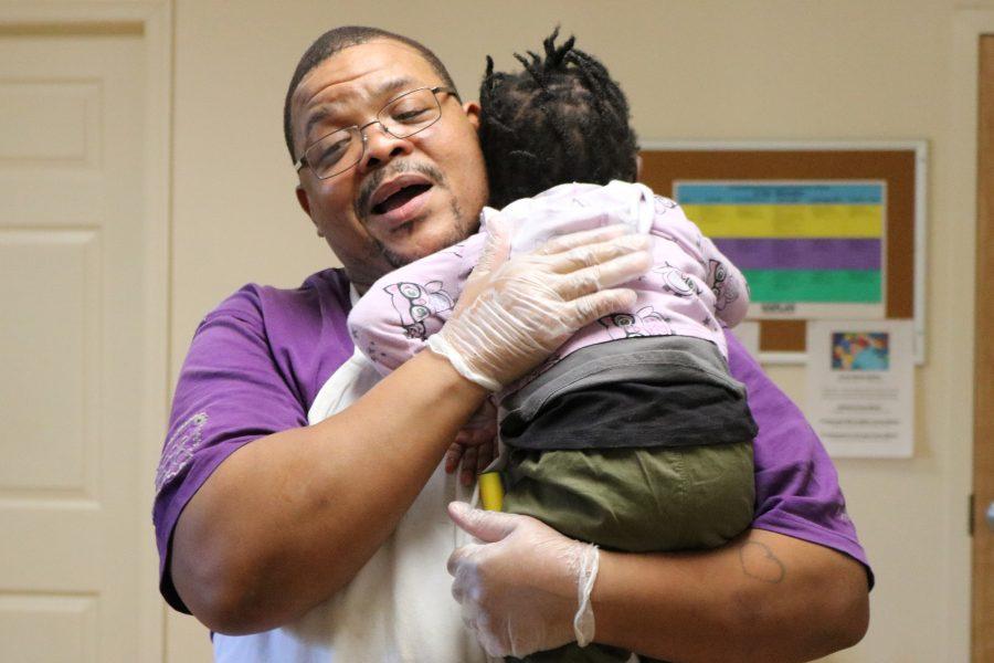 photo of man hugging child