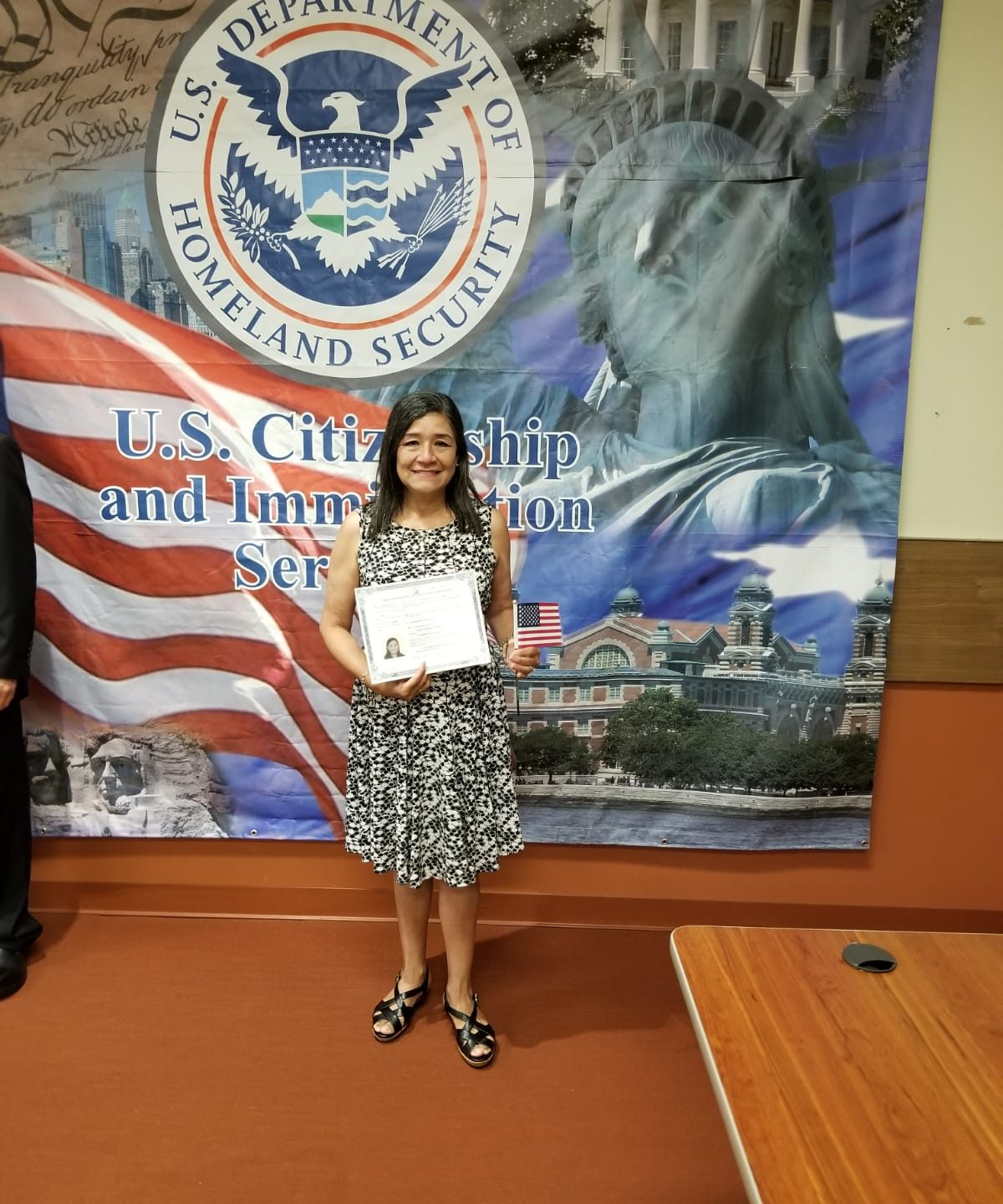 Photo of a woman at her US citizenship celebration